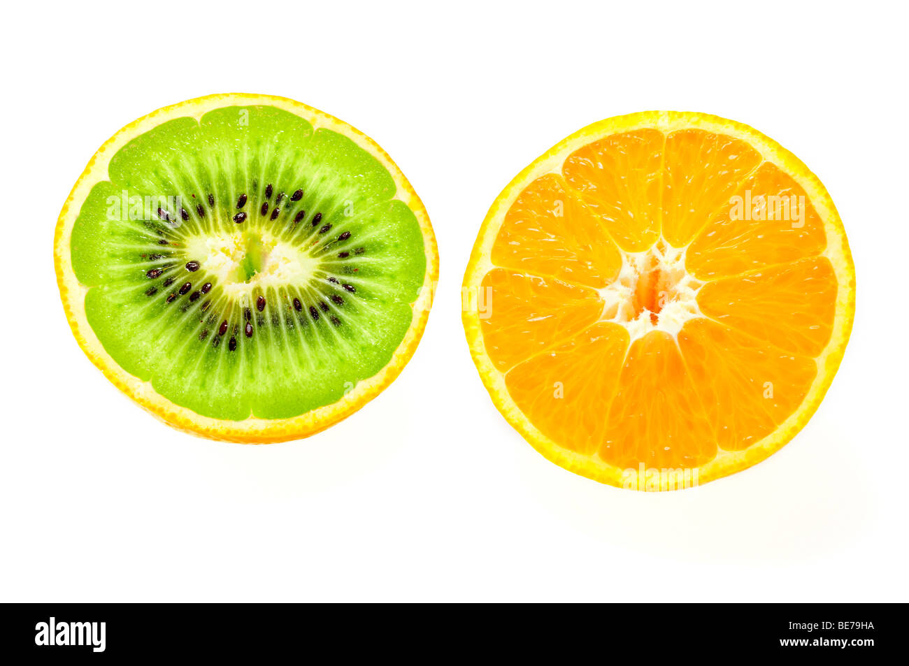 Orange filled with a Kiwi, symbolic image for genetic engineering - Stock Image