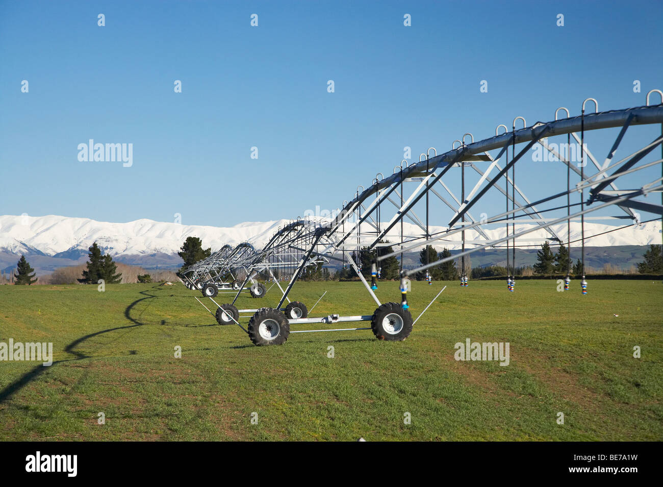 Centre Pivot Irrigation and Snowy Mountains near Pleasant Point, South Canterbury, South Island, New Zealand - Stock Image