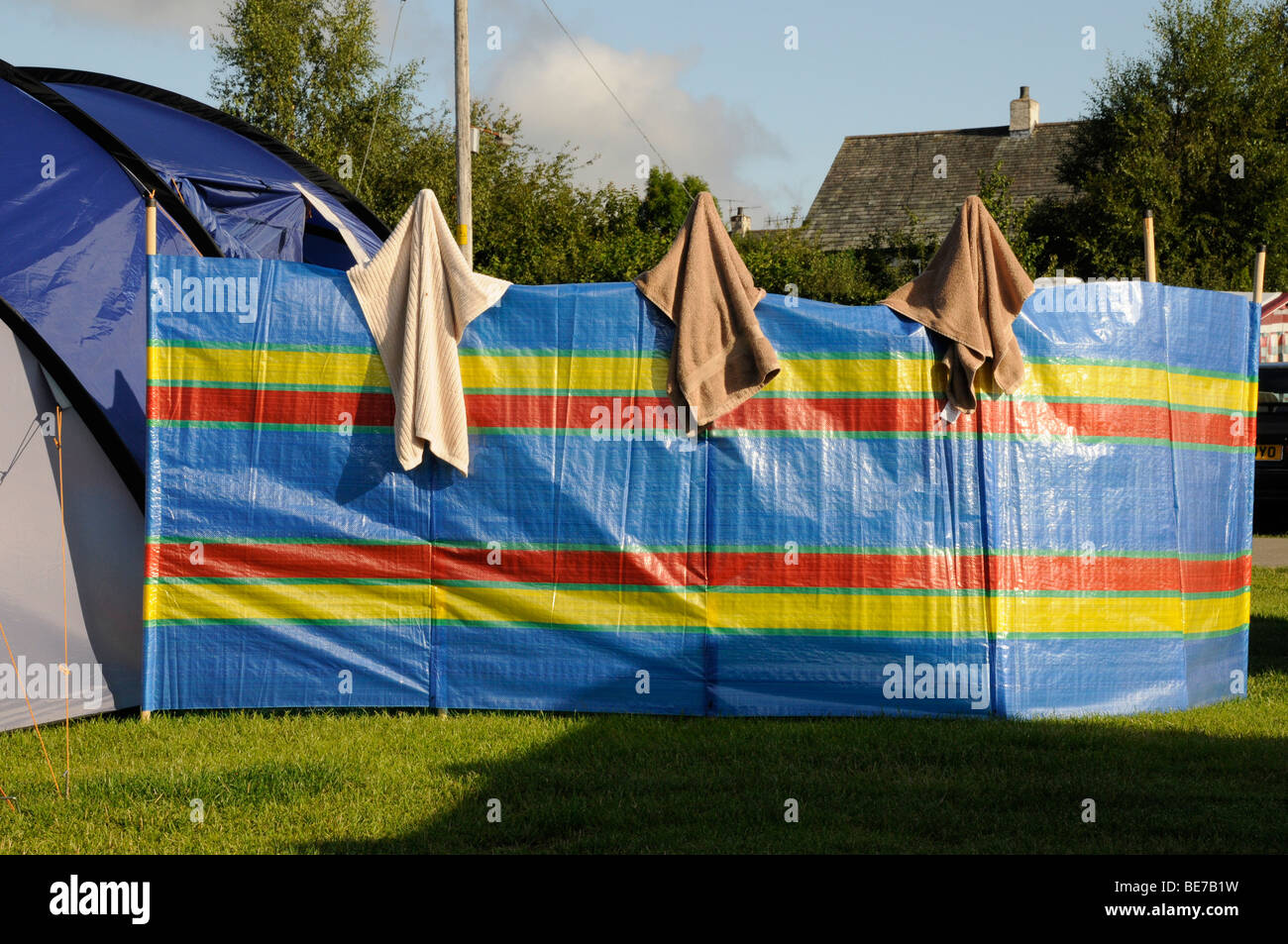 3 towels on a wind cheater dry. Camping in the Lake District on a stay-cation, Cumbria. United Kingdom. - Stock Image