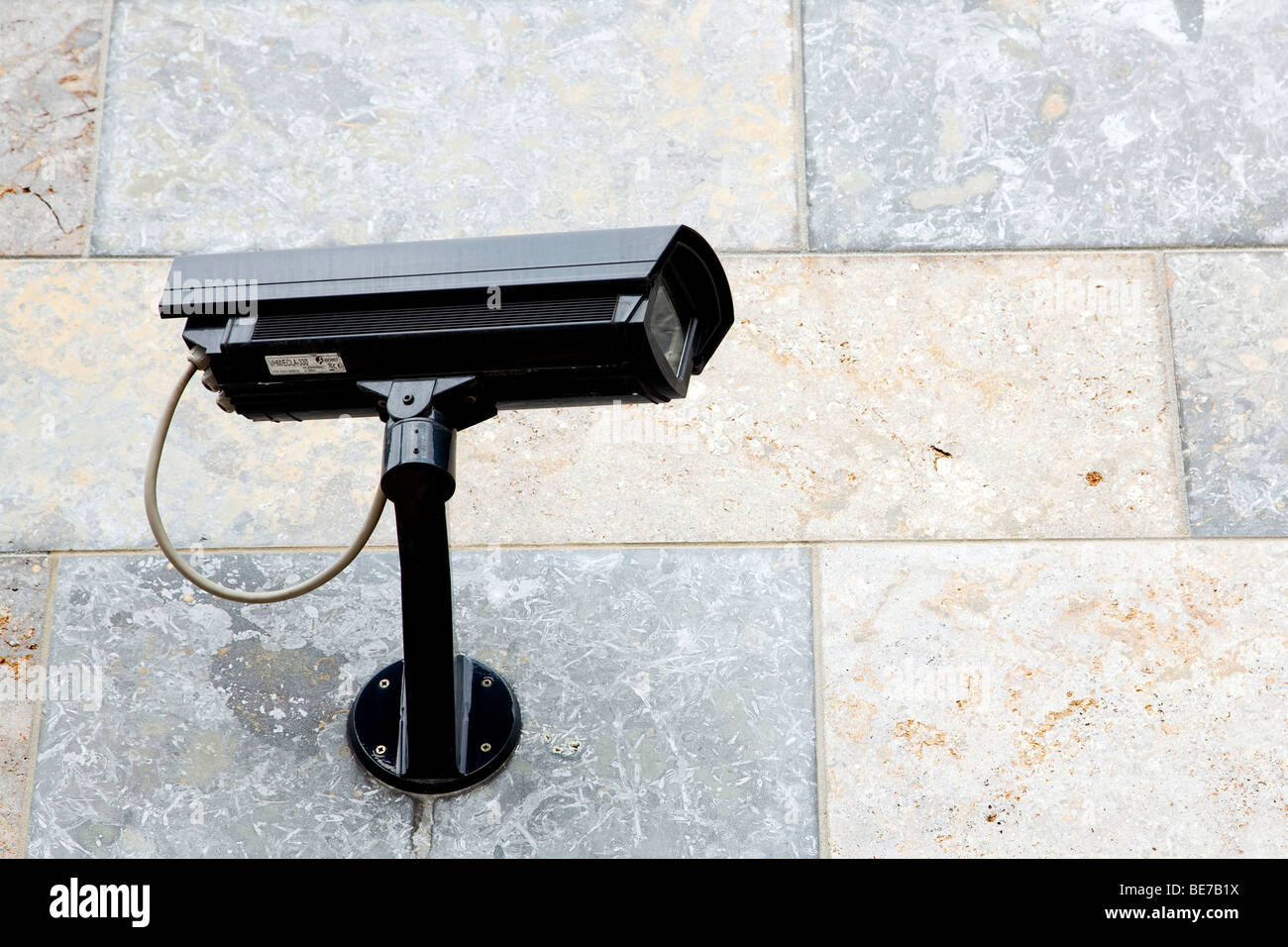 Surveillance camera on a house wall - Stock Image
