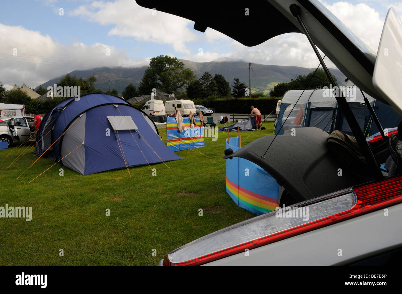 Setting up camp whilst camping in the Lake District on a stay-cation, Cumbria. United Kingdom. - Stock Image