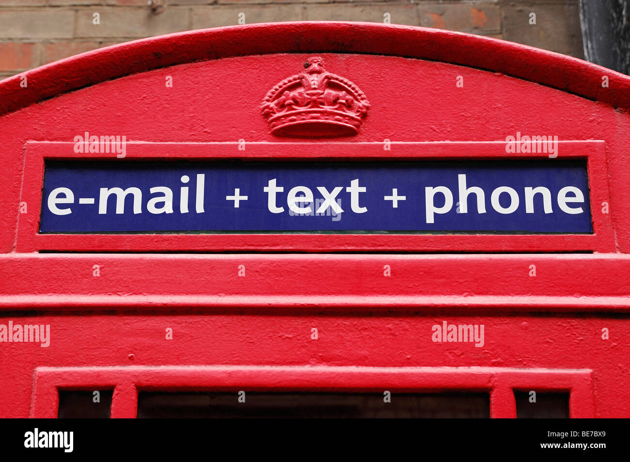 Traditional Red Telephone Box Offering Email, Text and Phone Services. Close Up, United Kingdom. Stock Photo