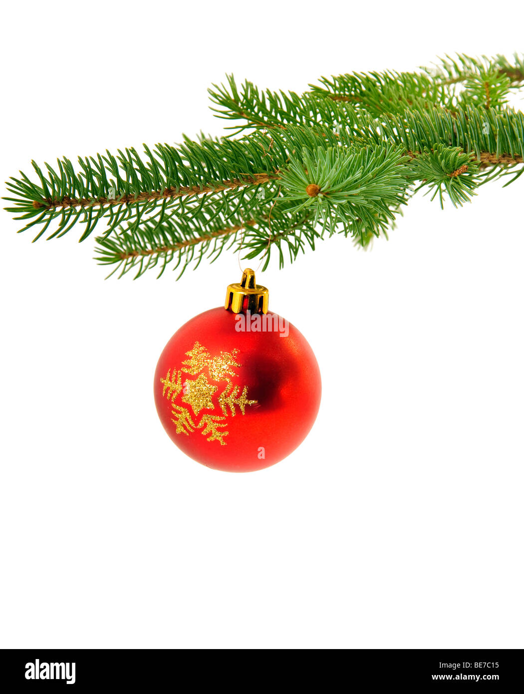 Christmas decoration on fir tree branch isolated over white background - Stock Image