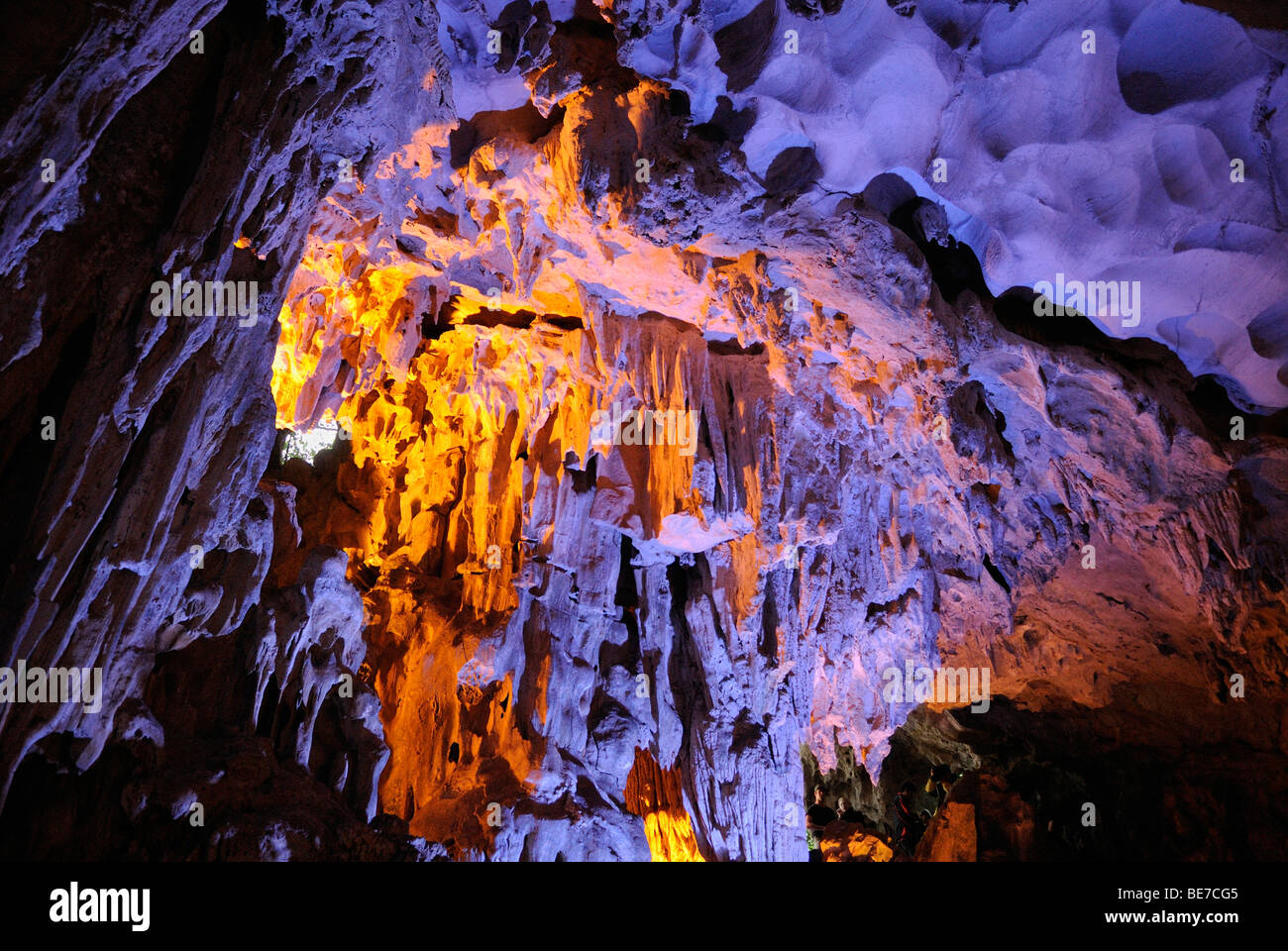 Colorful illuminated cave at Halong Bay, UNESCO World Heritage Site, Vietnam, Asia Stock Photo