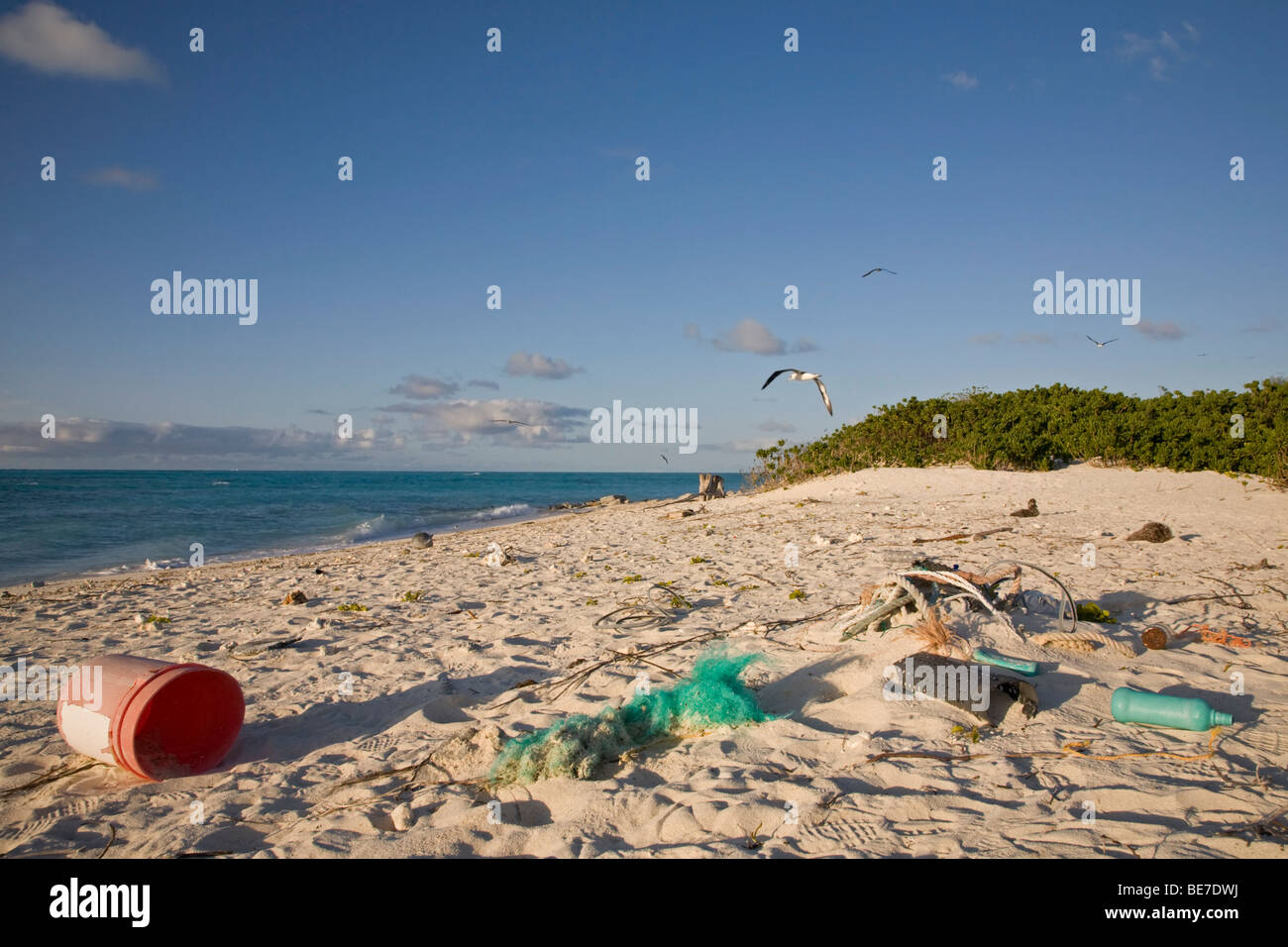 Marine debris washed ashore on beach of a North Pacific island - Stock Image