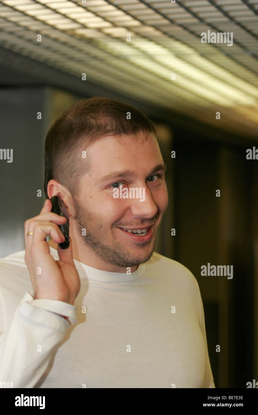 Russian businessman, mobile phones tycoon Yevgeny Chichvarkin shows mobile phone during Russian economic forum in - Stock Image