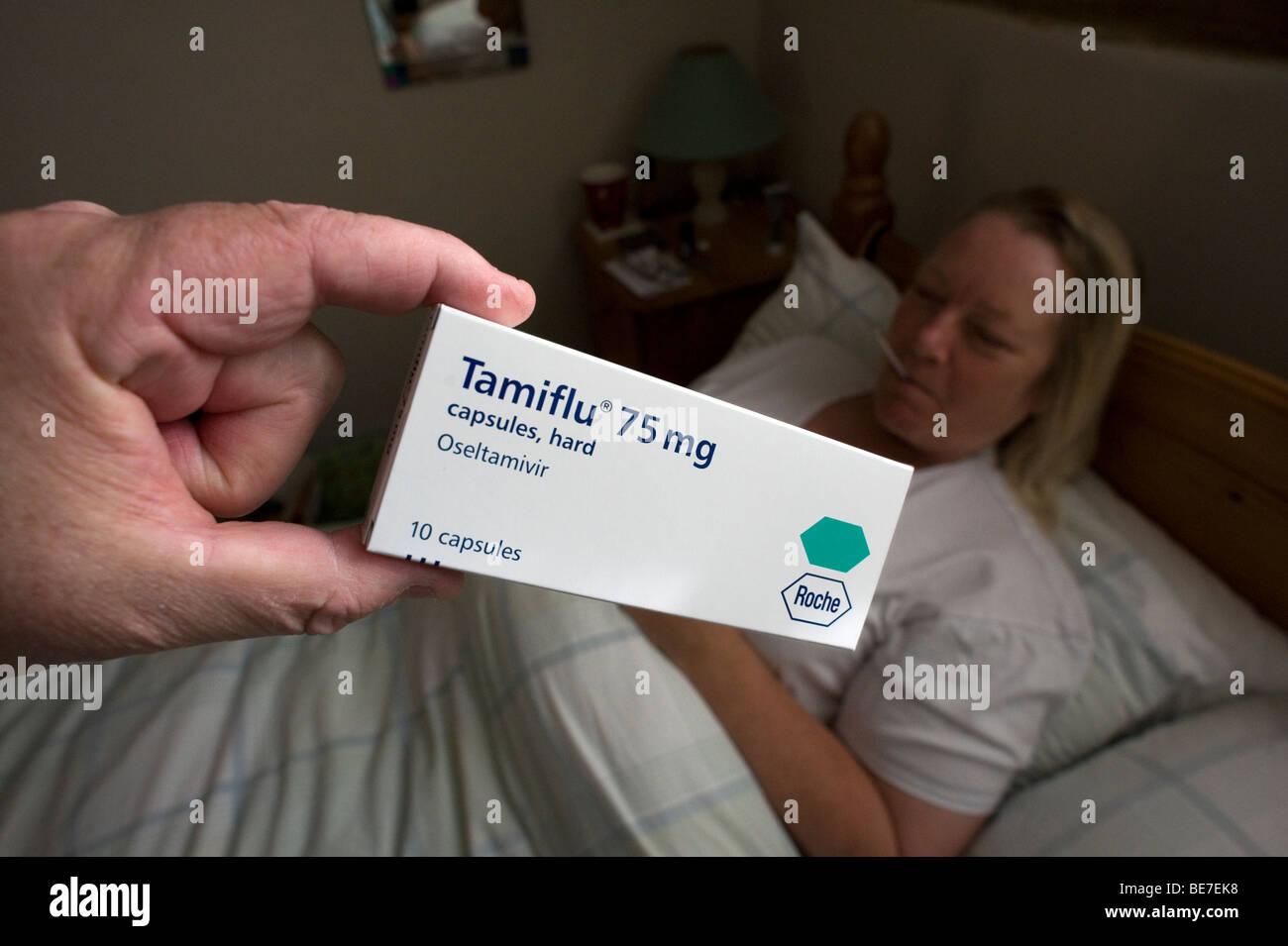 Swine Flu Tamiflu Roche ill temperature woman real model released - Stock Image