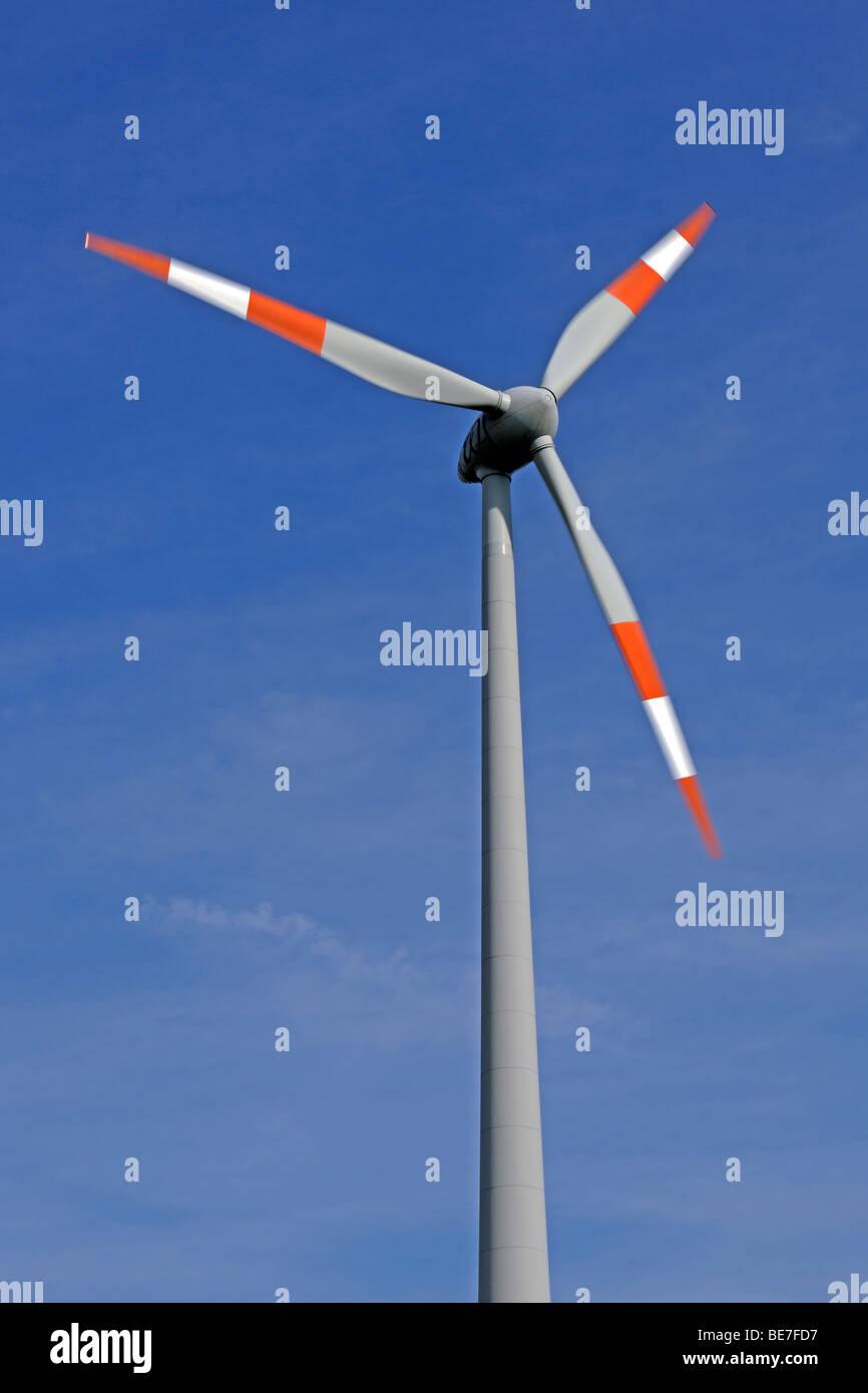 Wind turbine with rotating blades, renewable energy - Stock Image