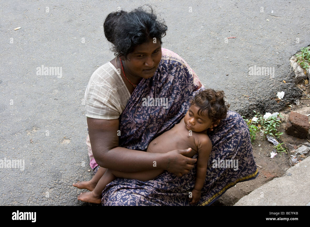 Woman with baby begging in the street in Pondicherry India Stock Photo