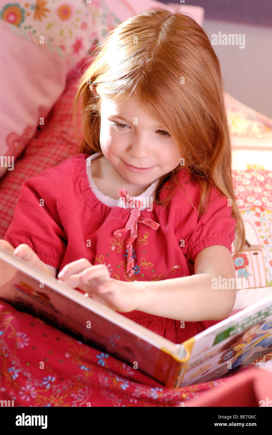 Little girl reading a picture book Stock Photo
