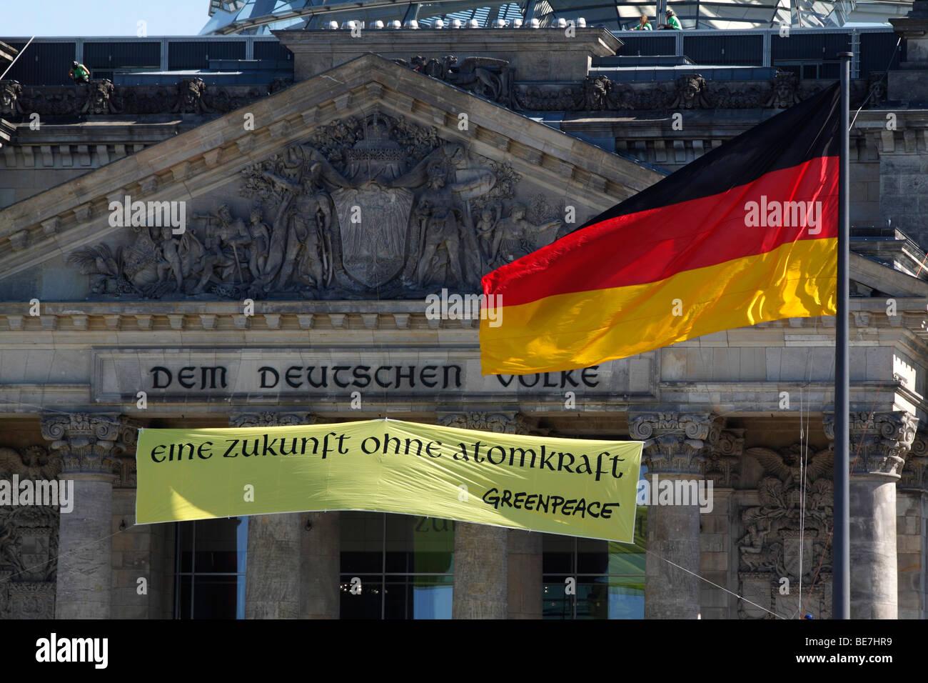 Reichstag building. The dedication ' Dem Deutschen Volke '.( For the German people ), protest sign eine - Stock Image