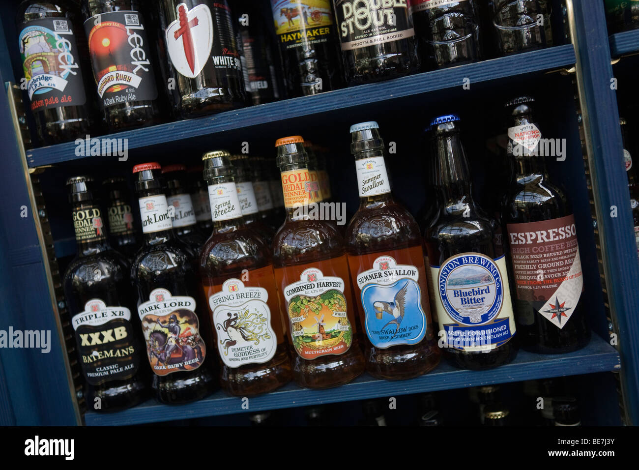 Shelf with bottles of beer from Micro breweries - Stock Image