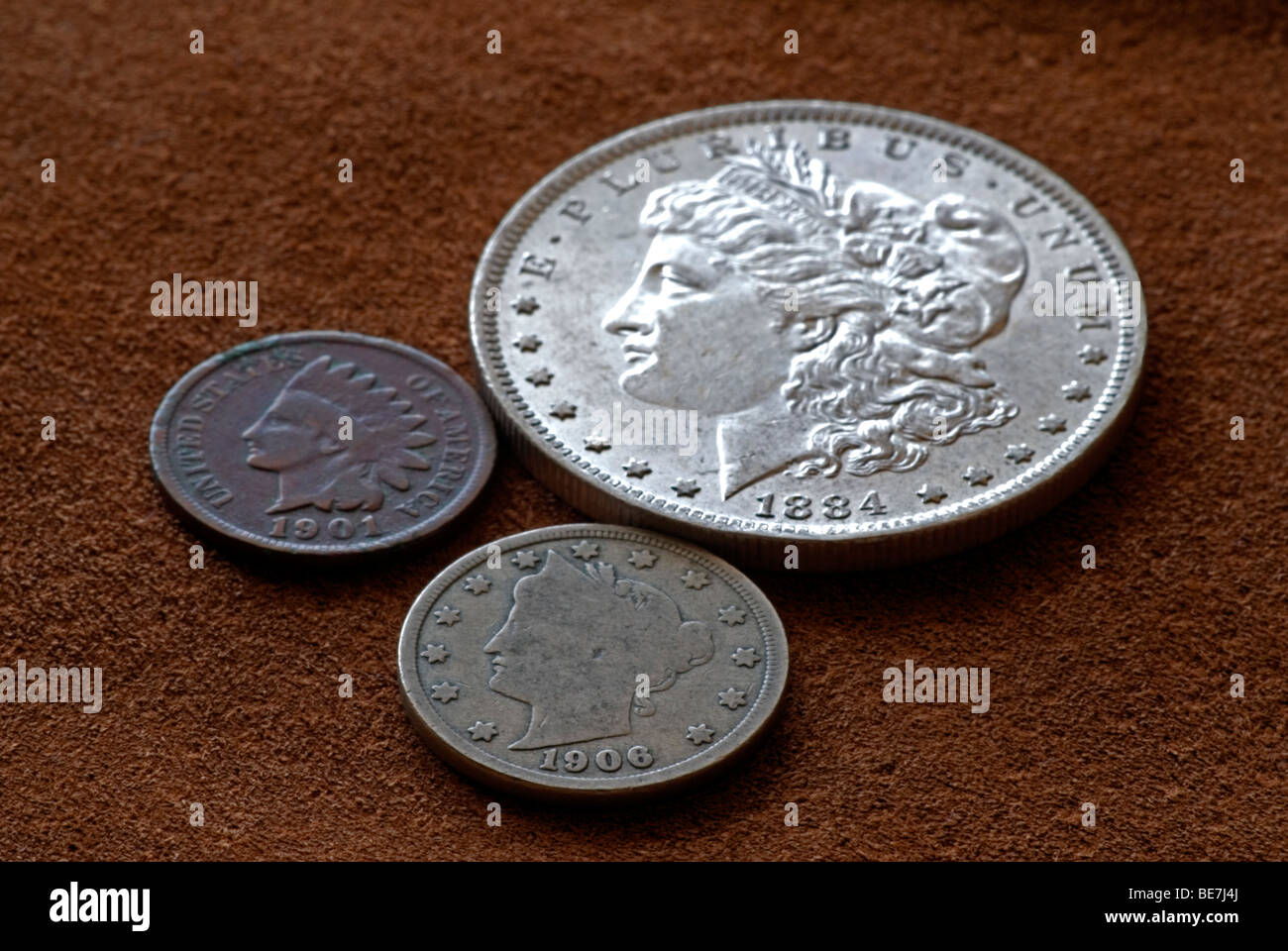 Old United States coins photographed on leather, Colorado US - Stock Image