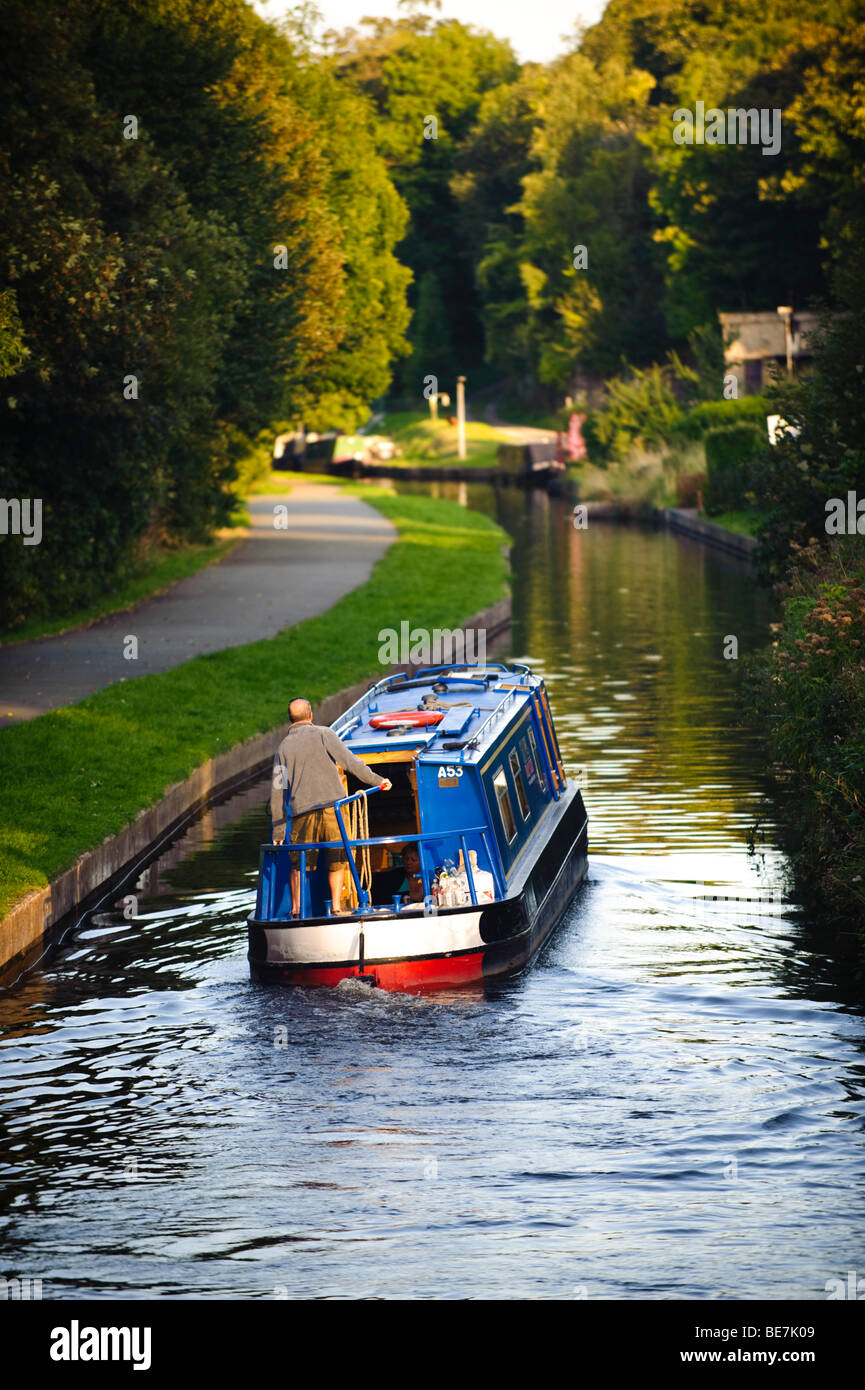 Summer evening - a Couple on a Narrowboat holiday on the Llangollen Canal, North wales UK Stock Photo