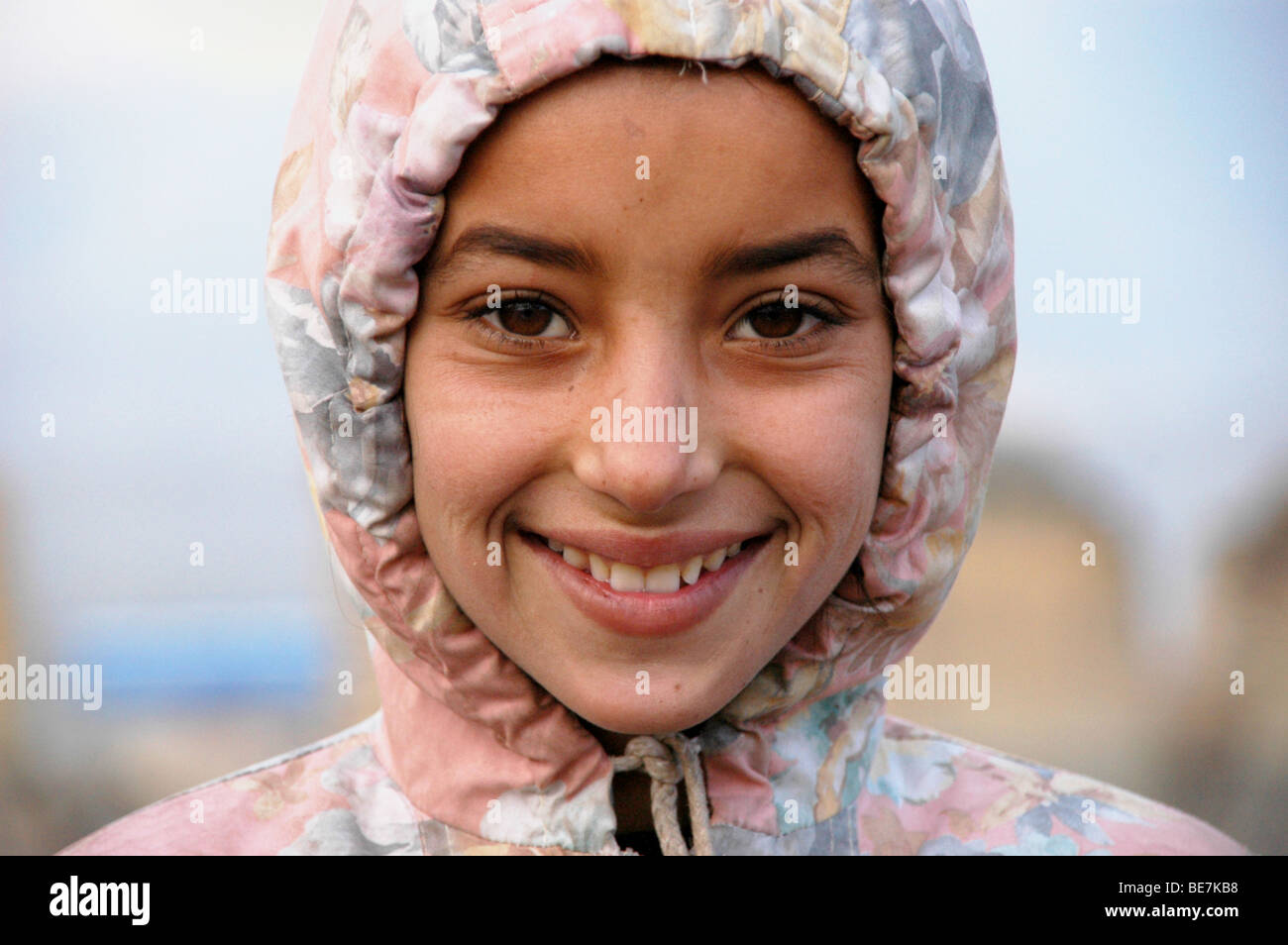 A portrait of a young, impoverished Afghan girl taken on the outskirts of Kabul, Afghanistan. - Stock Image