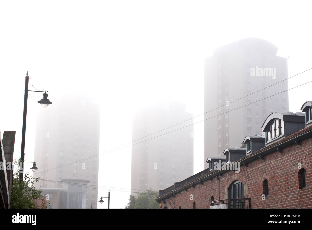 City apartments on misty day Stock Photo
