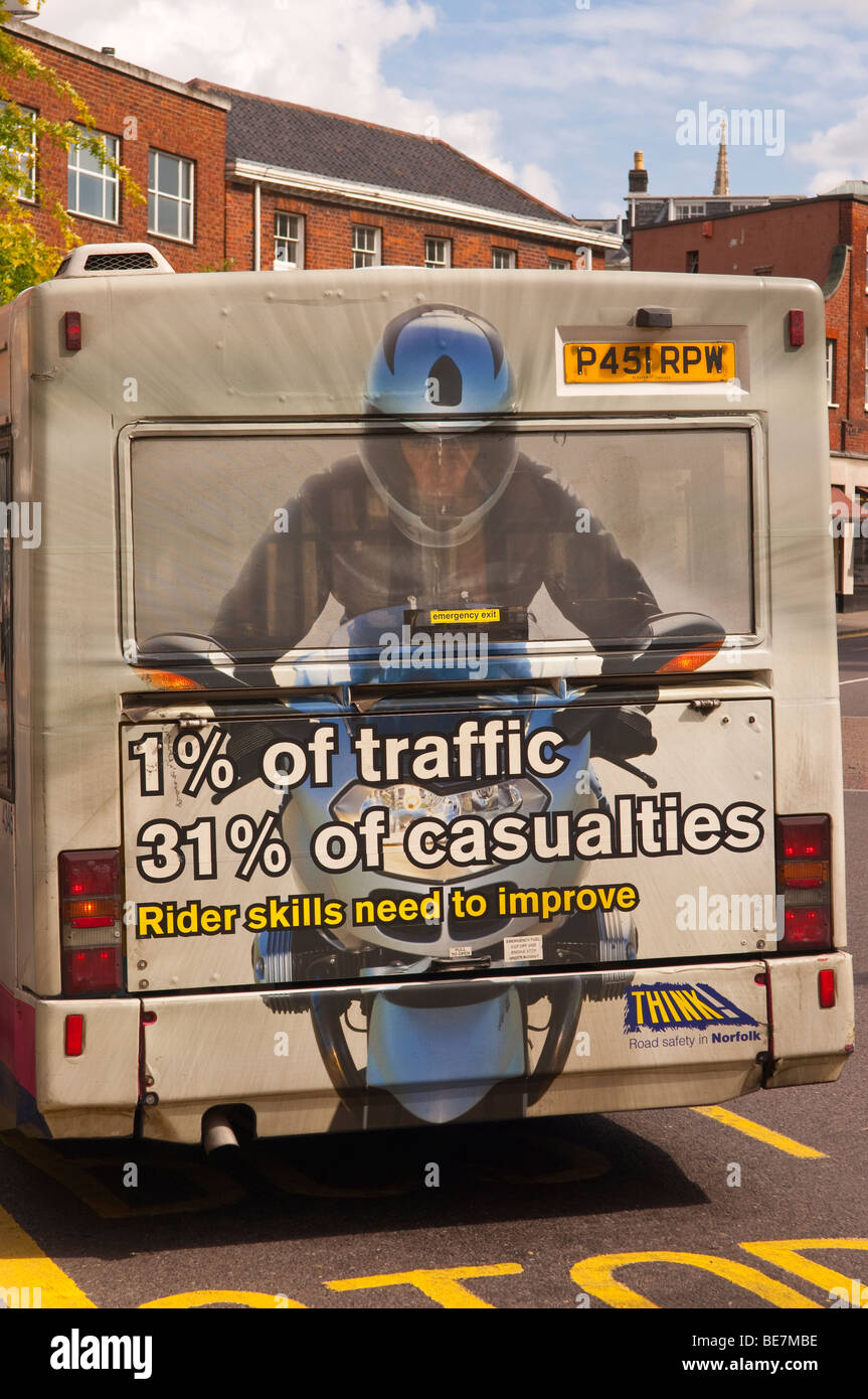 An advert sign on the back of a bus warning of the danger of motorbikes on the roads in Norwich , Norfolk , Uk - Stock Image