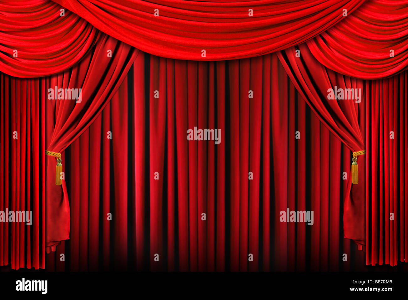 Curtains from a Stage in Bright Red Dramatic Lighting - Stock Image