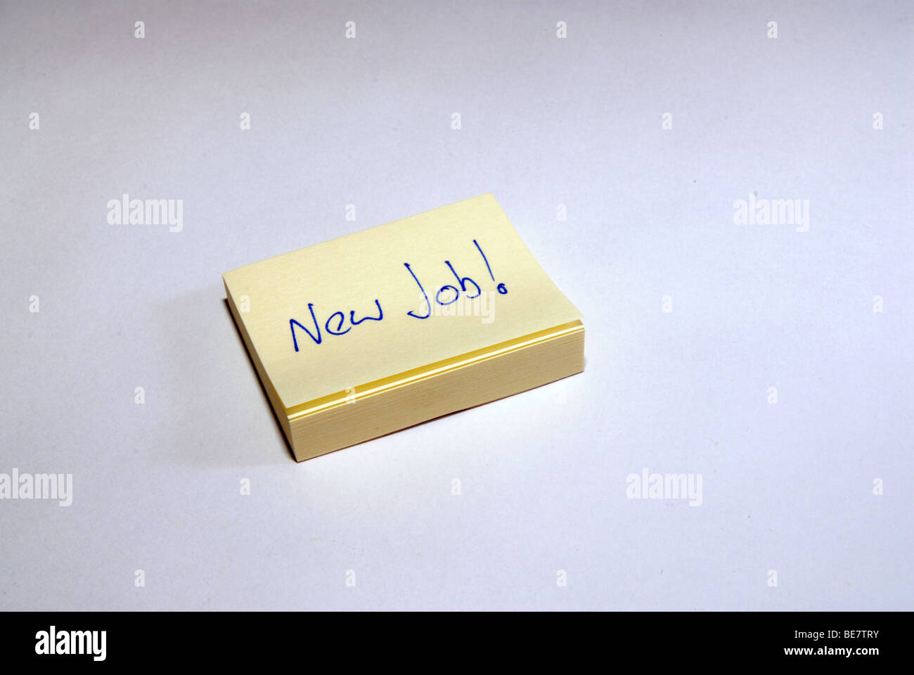 Get a New Job reminder on a post it note - Stock Image