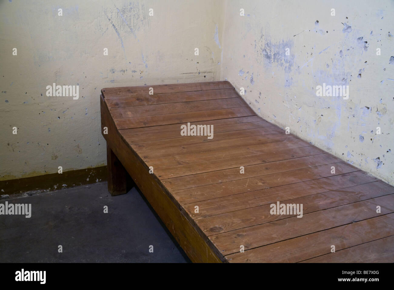 Cot in a windowless cell for solitary confinement, Berlin-Hohenschoenhausen memorial, former prison of the GDR's - Stock Image