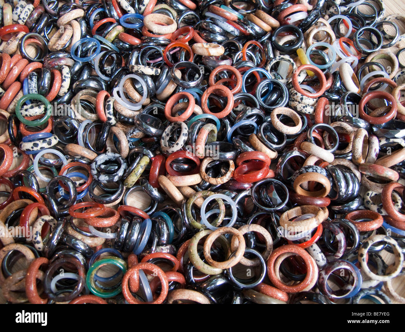 Plastic ring bands for sale on sunday market - Stock Image
