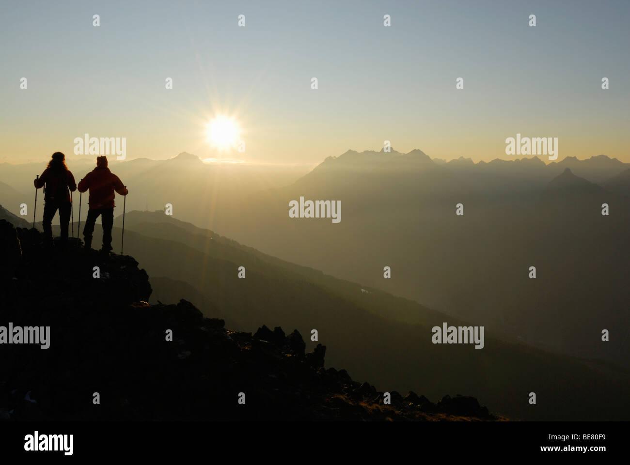 Two Hikers on Glanderspitze looking at Krahberg and Lechtaler Alpen range, Venet, Oetztaler Alpen range, Tyrol, - Stock Image