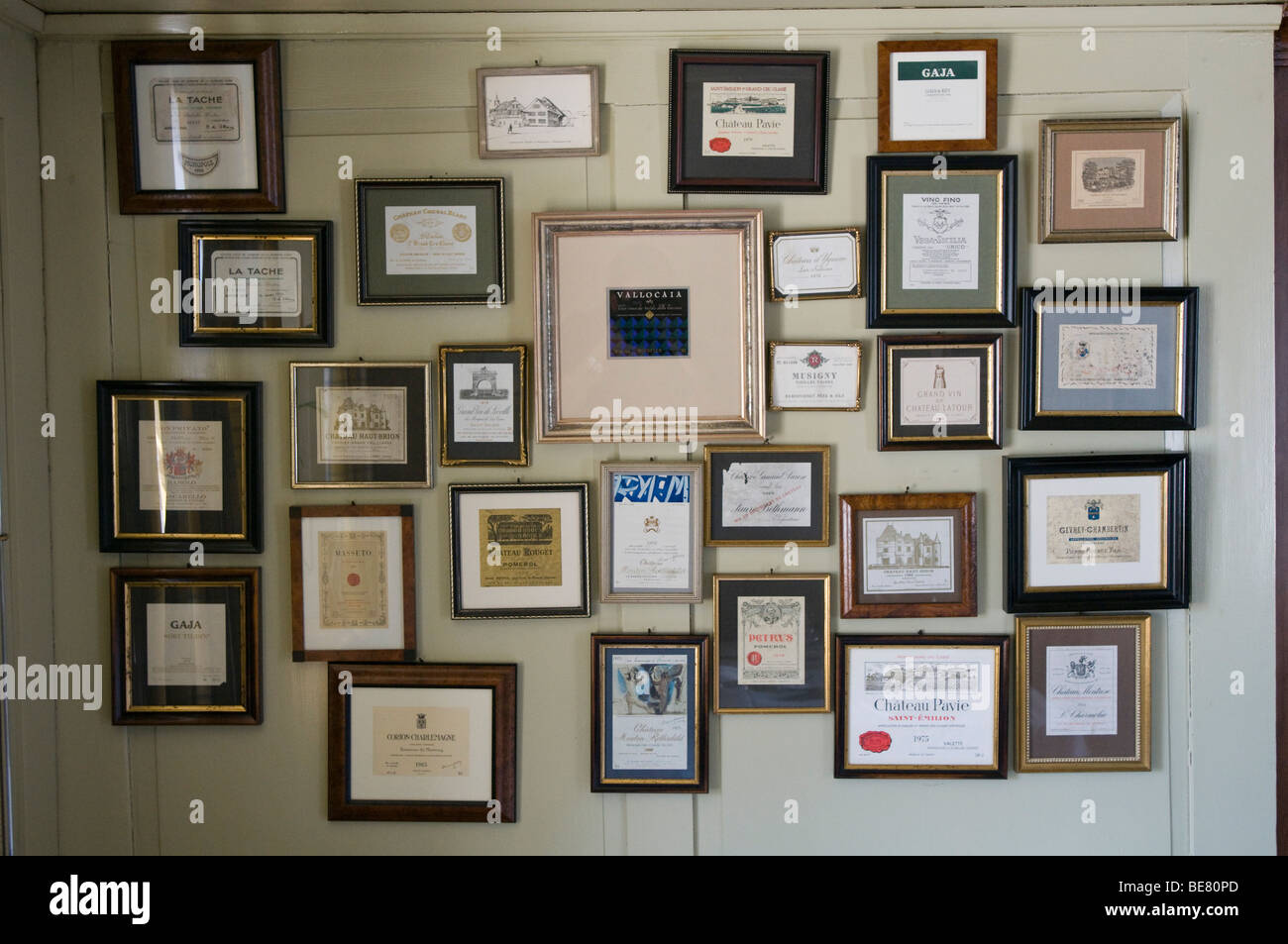 Decoration, photo frames with wine labels hung on the wall, Restaurant Taverne Zum Schaefli, Owner and head chef - Stock Image