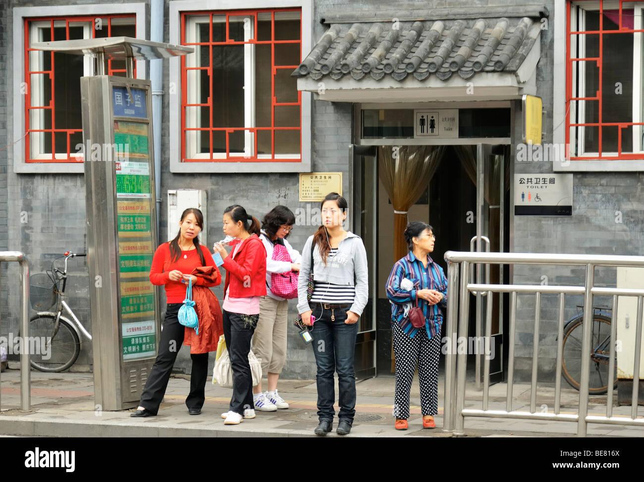 0881adb121 Chinese women waiting at the bus stop Guozijian near the Lama temple Yong  He Gong