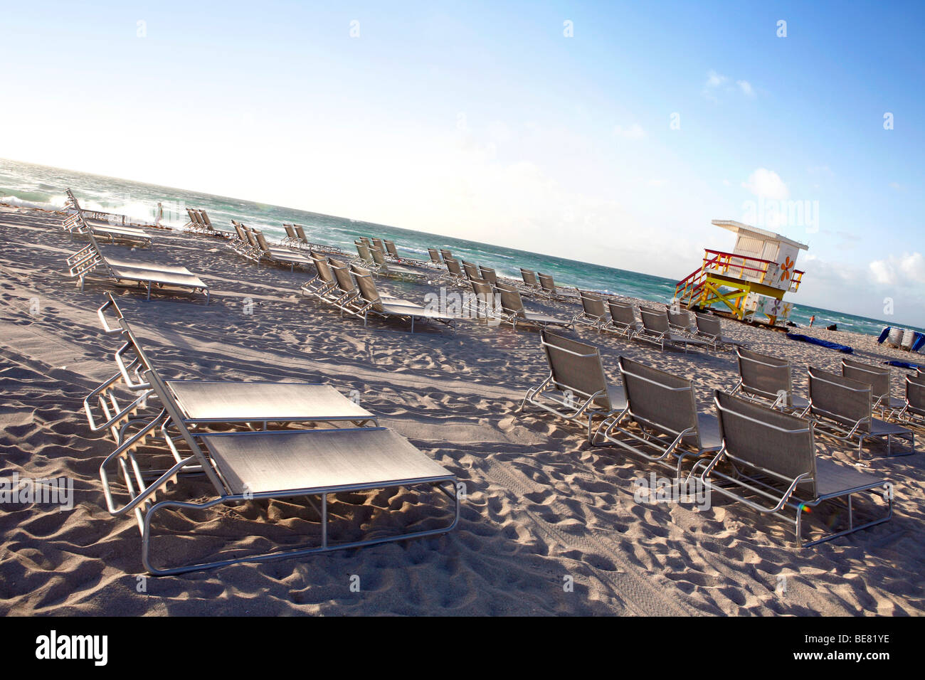 Deck chairs on the deserted South Beach, Miami Beach, Florida, USA - Stock Image