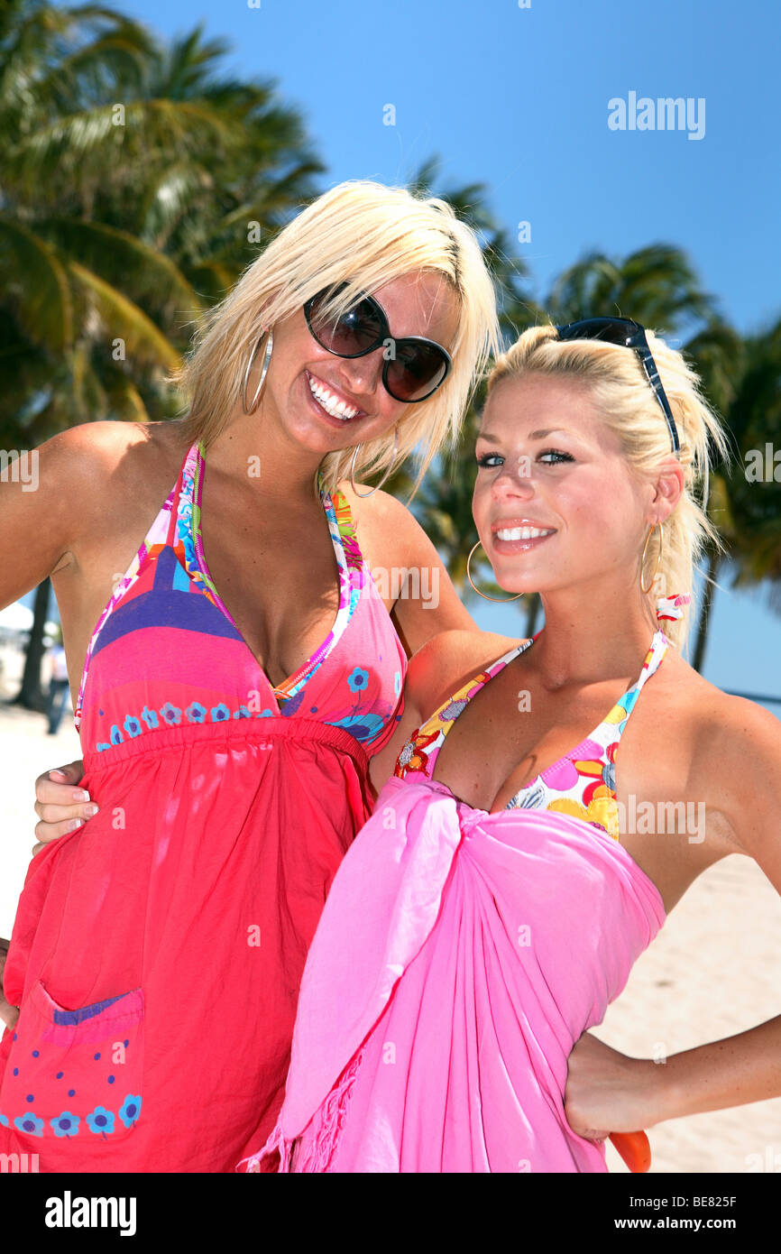 Two laughing blondes in the sunlight, South Beach, Miami Beach, Florida, USA - Stock Image