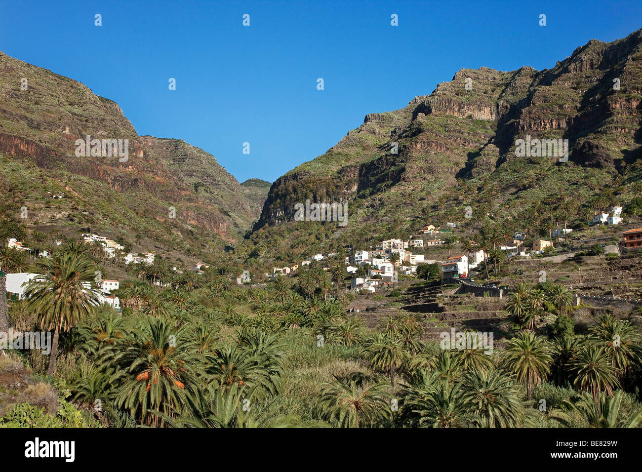 A mountain village at Valle Gran Rey under blue sky, La Gomera, Canary Islands, Spain, Europe - Stock Image