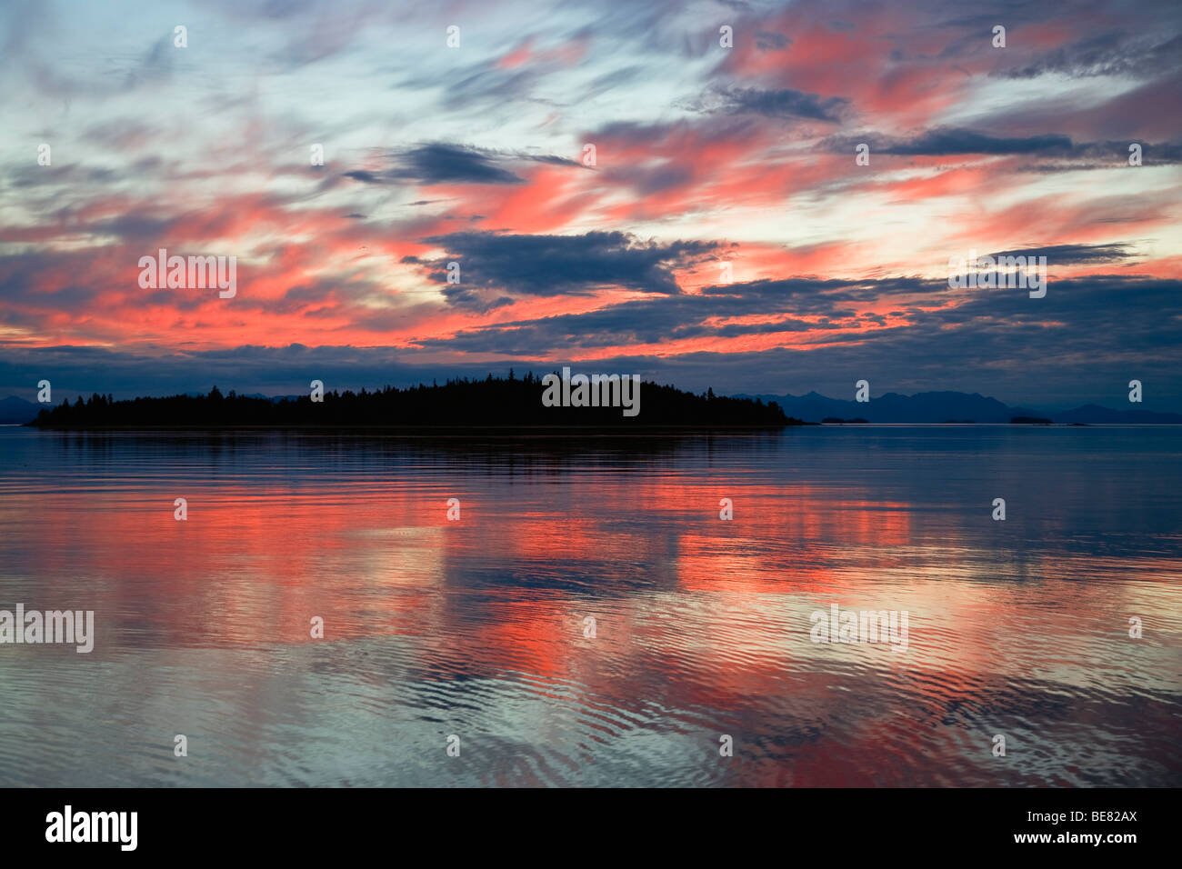 The sea and coastline in the afterglow, Inside Passage, Southeast Alaska, USA - Stock Image