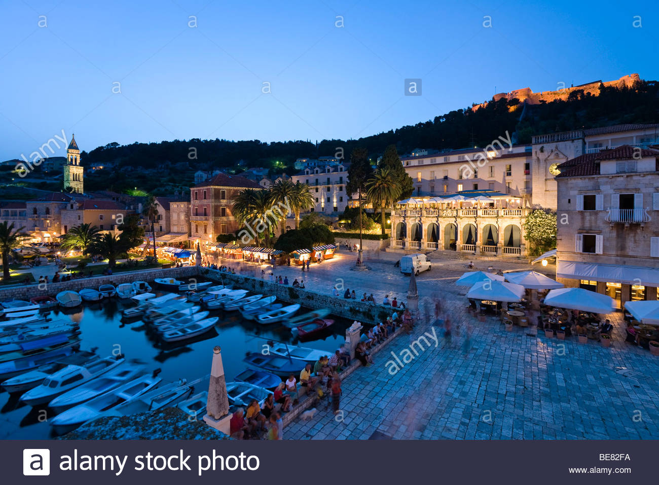 Harbour and palace hotel at the Old Town in the evening, Hvar, Hvar Island, Dalmatia, Croatia, Europe - Stock Image
