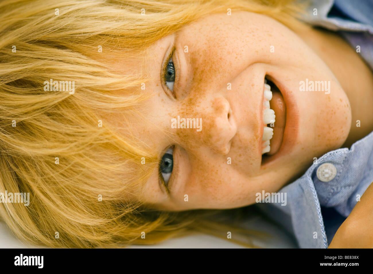 Little boy smiling, portrait - Stock Image