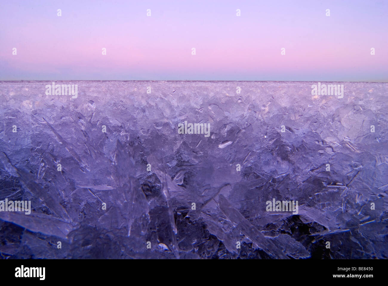 tidal flats of the kwade hoek nature reserve after sunset with ice cristals - Stock Image