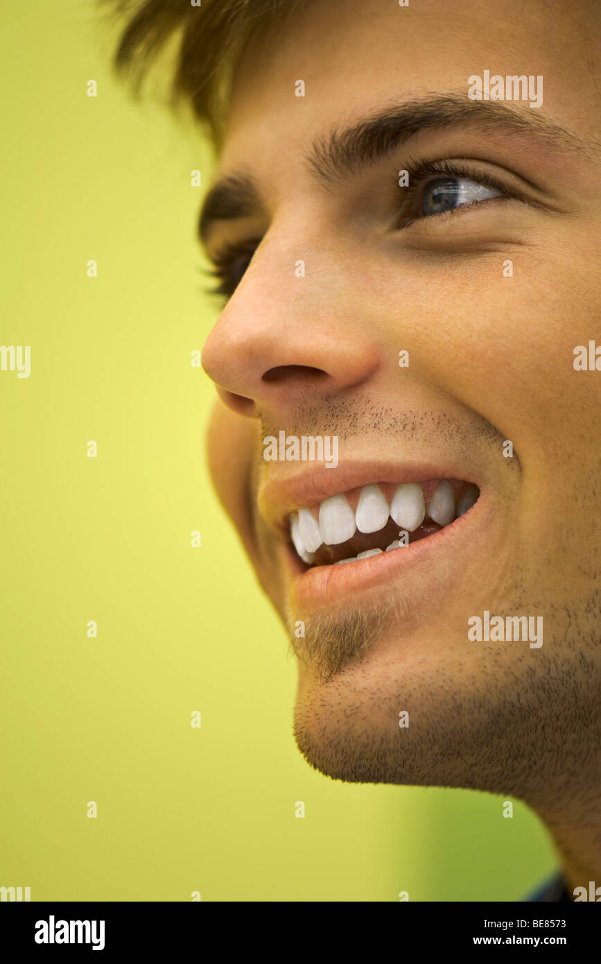 Young man smiling, portrait - Stock Image