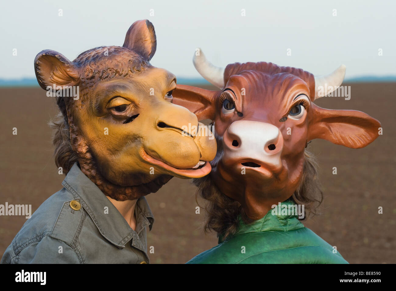 Two people wearing animal masks, close-up Stock Photo
