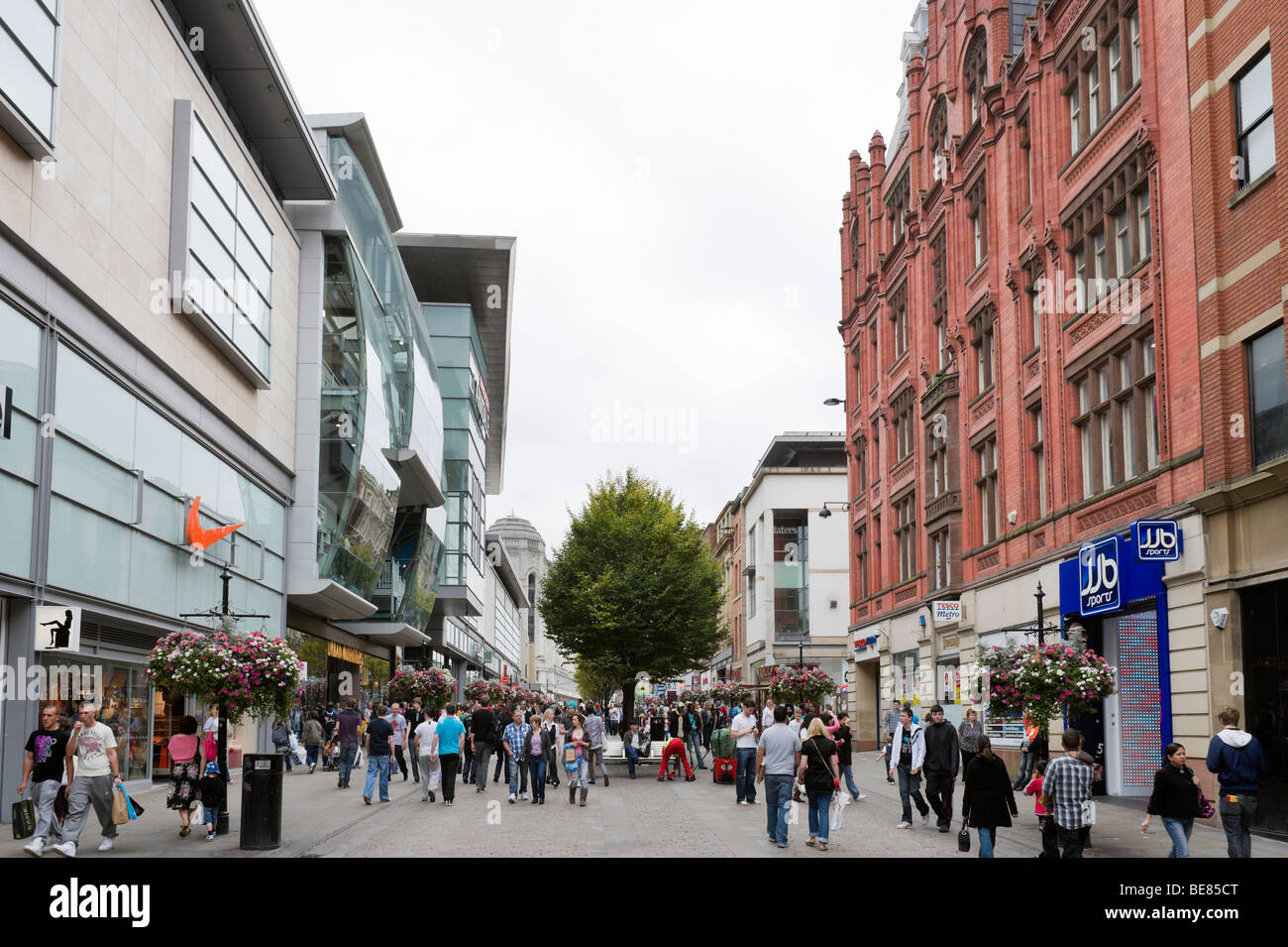 Major shops and department stores on Market Street near the Arndale Centre, Manchester, England - Stock Image
