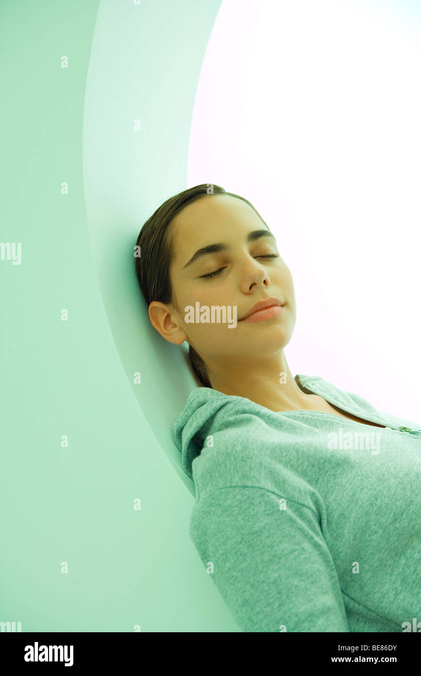 Teen girl resting, eyes closed - Stock Image
