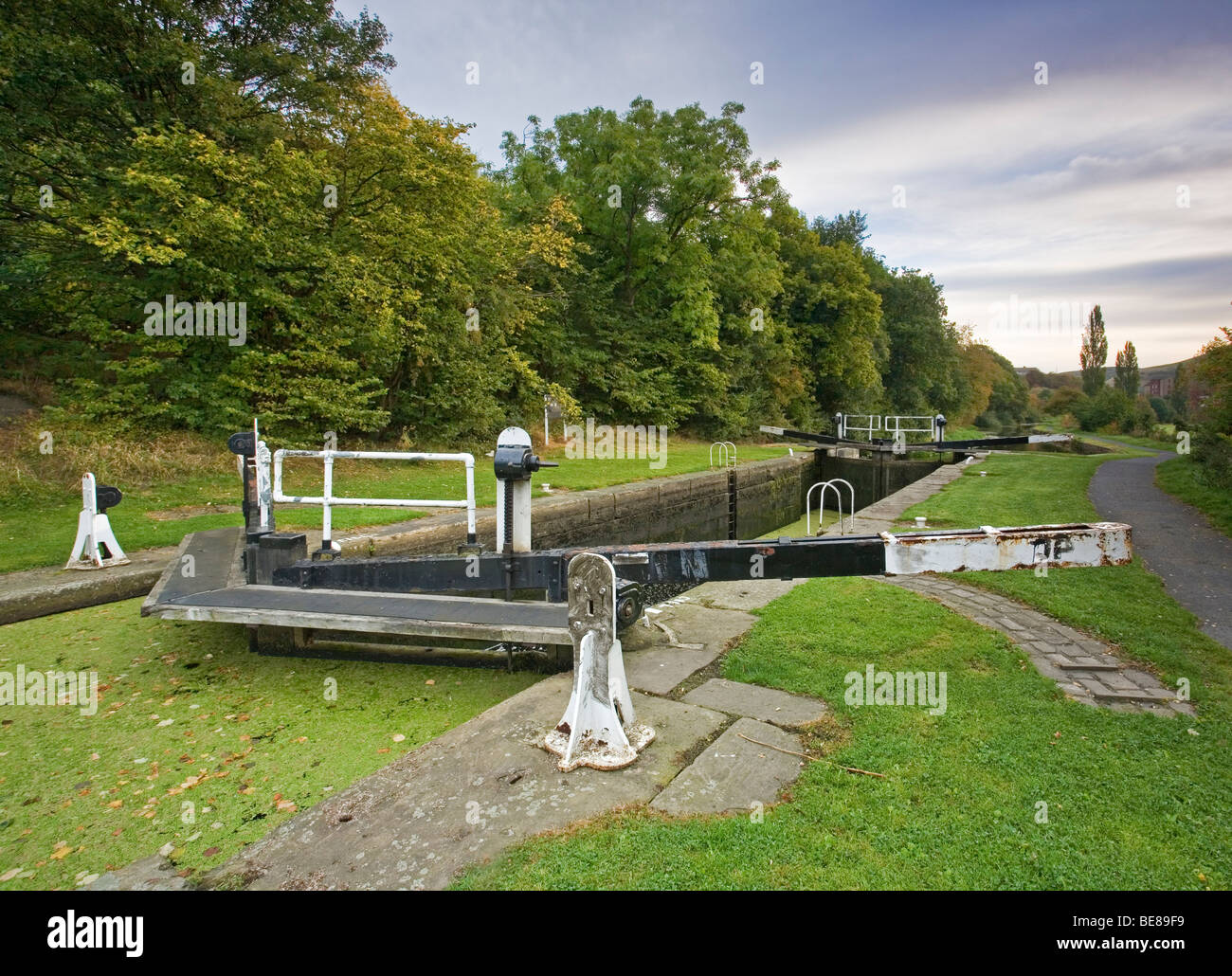 Lock Gates and Towpath on the Huddersfield Broad Canal at Bradley near Huddersfield, West Yorkshire, UK - Stock Image