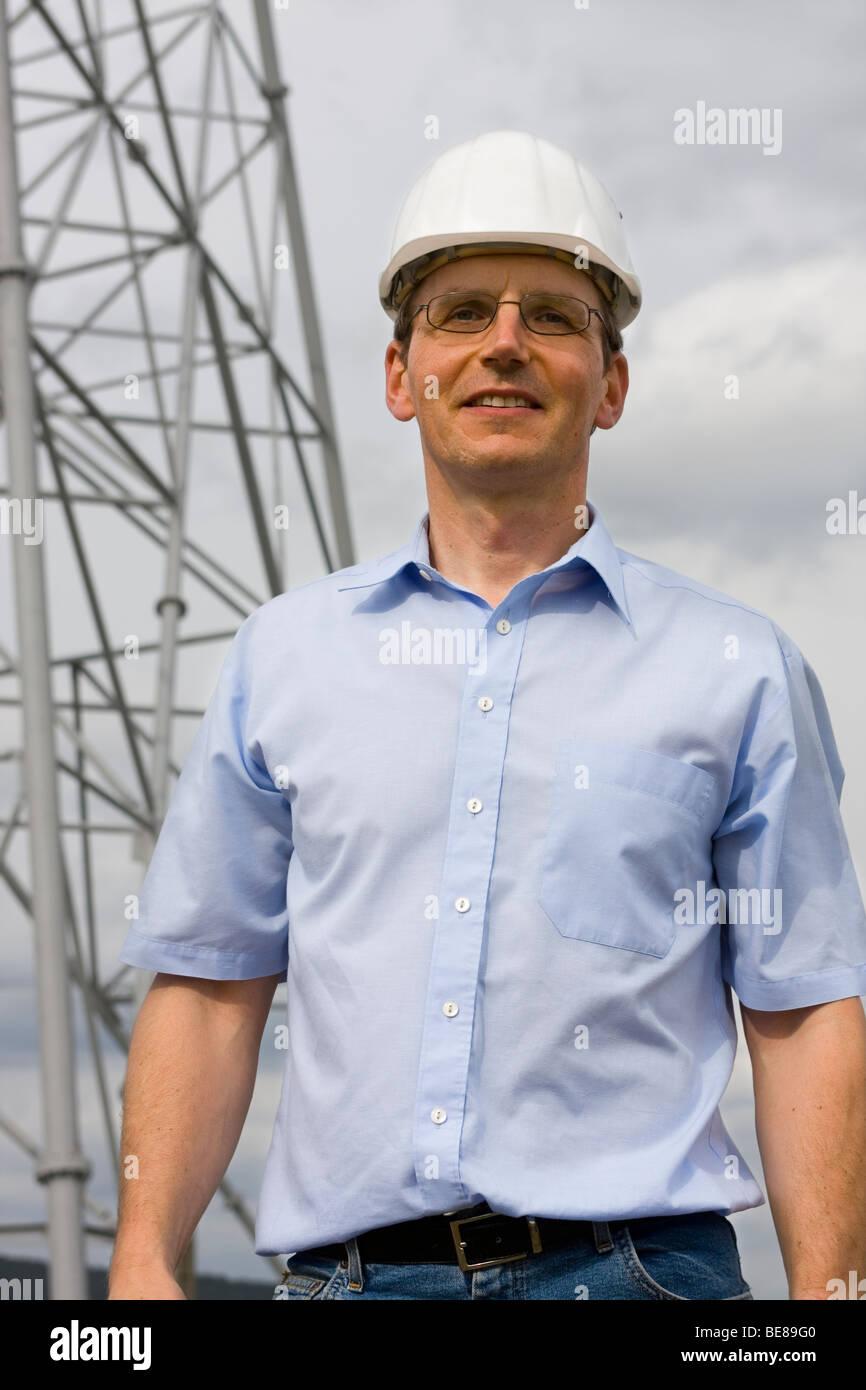 Smiling architect on construction side - Stock Image