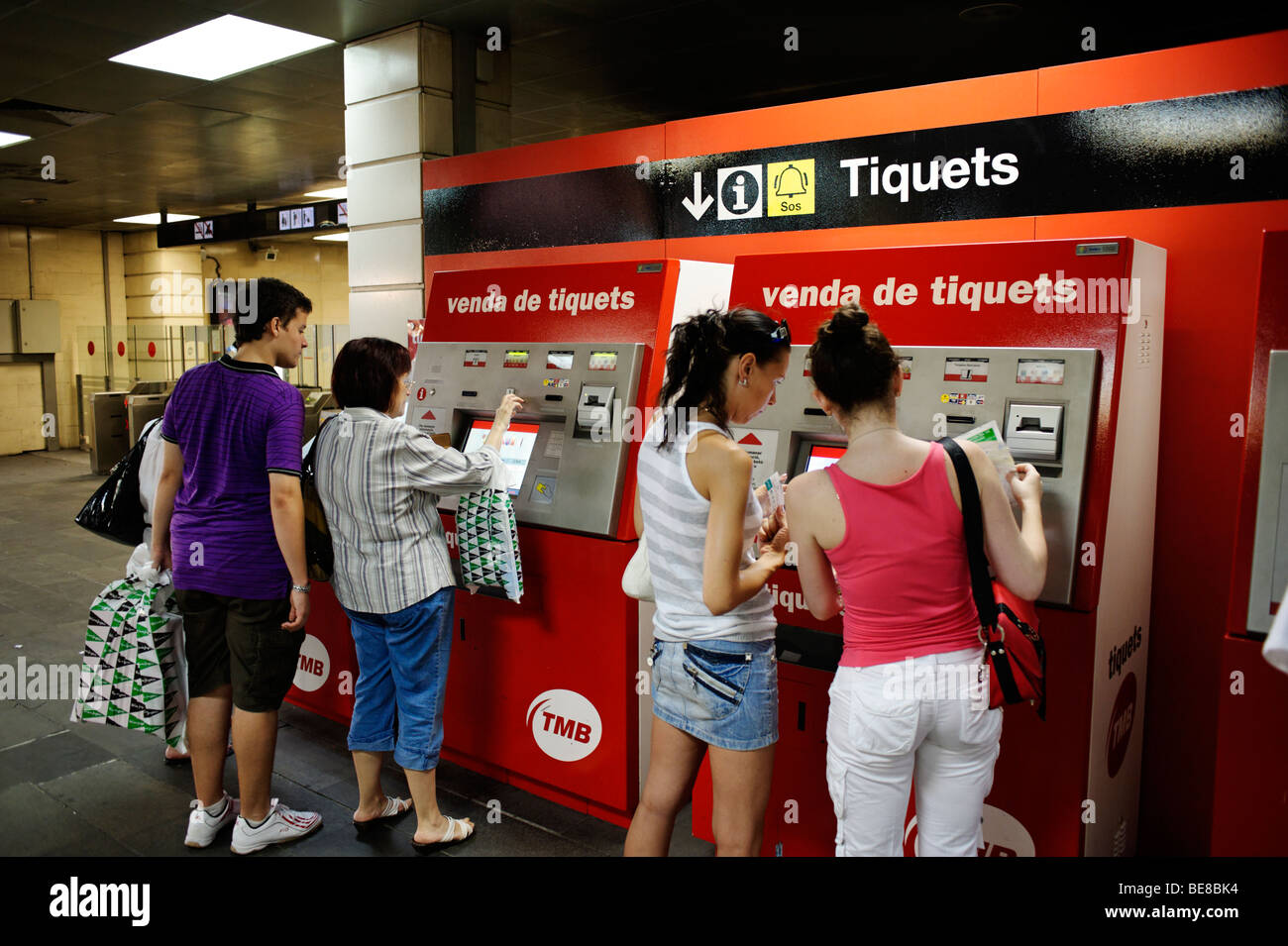 People buying metro tickets at a vending machine. Barcelona. Spain - Stock Image