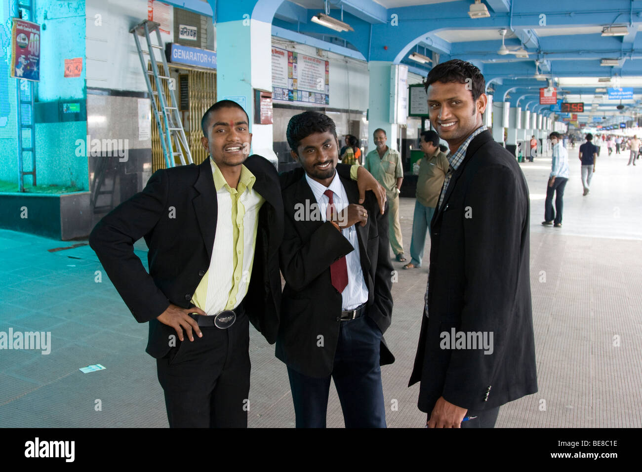 Indian businessmen at the railway station in Hyderabad India - Stock Image