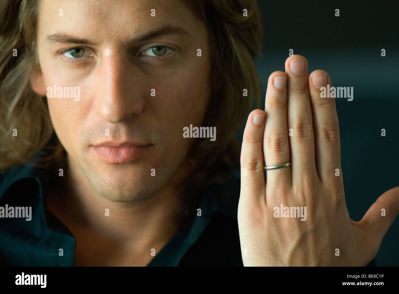 Man Holding Up Hand Showing Wedding Ring Stock Photo 26000626 Alamy