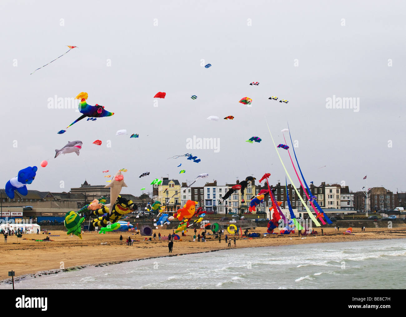 A kite festival on the beach at Margate in Kent. - Stock Image