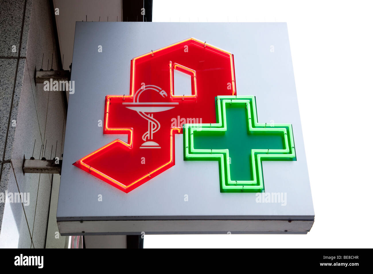 Pharmacy sign with logo and green cross - Stock Image