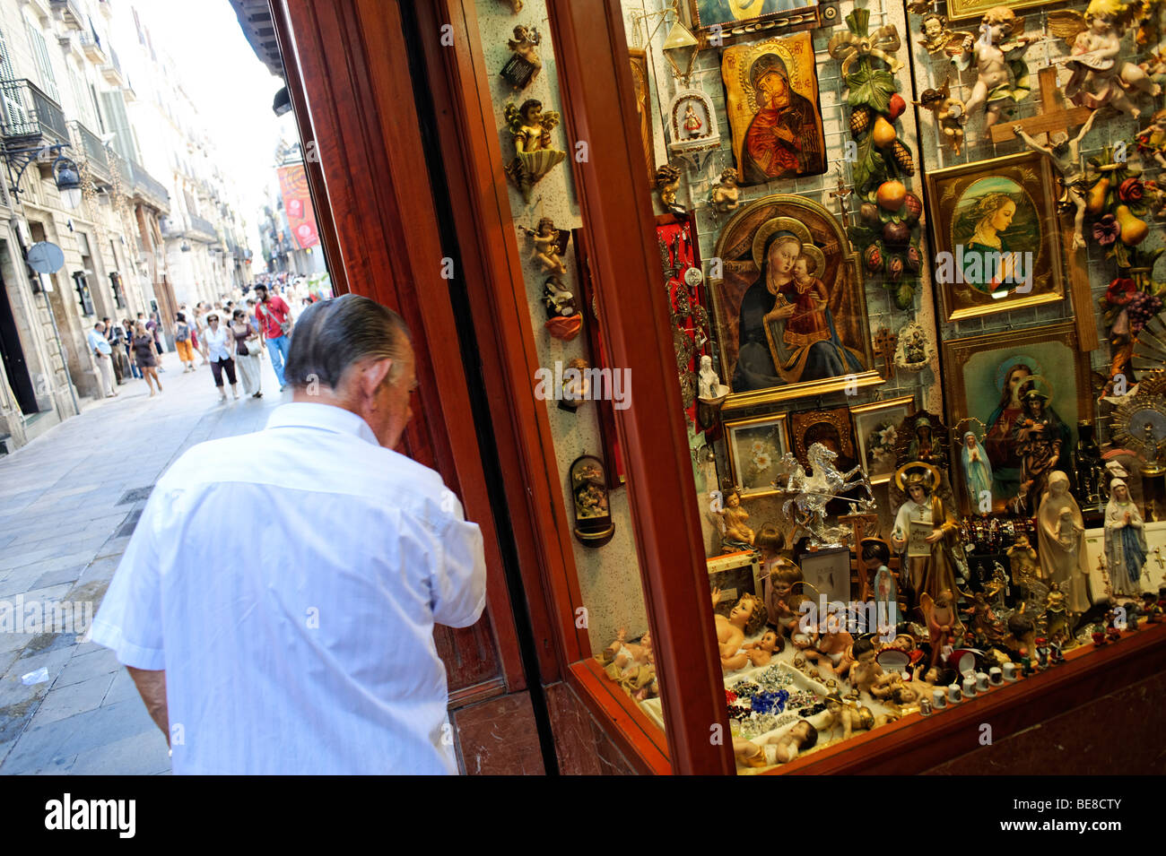 Old traditional shop selling catholic iconography in Barri Gotic. Barcelona. Spain - Stock Image