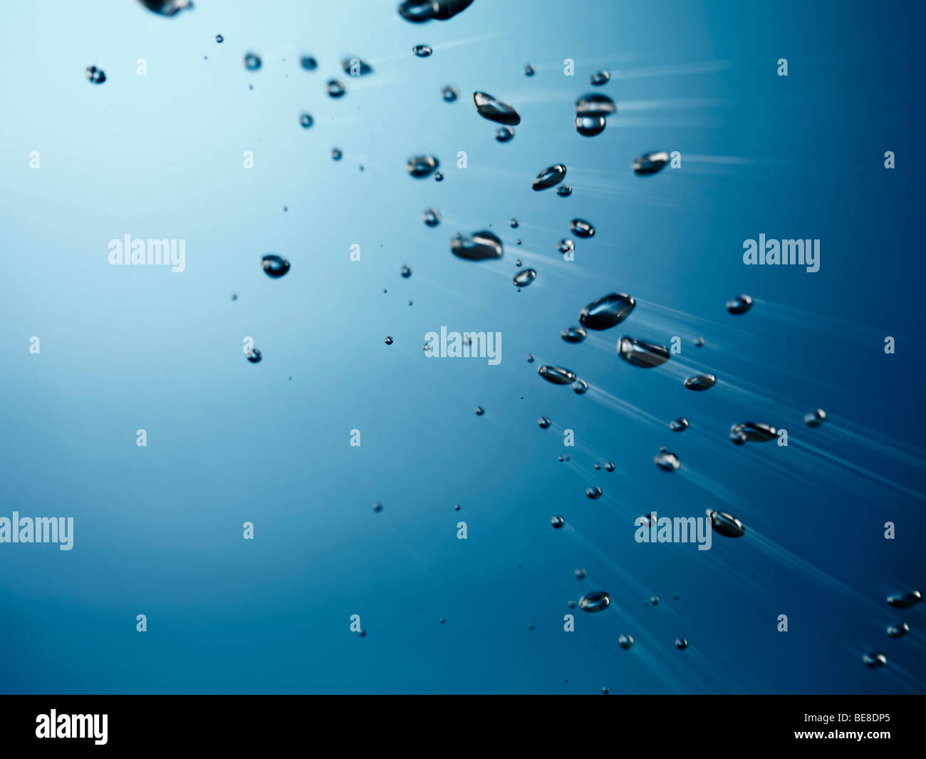 Oxygen bubbles rising to the surface of water - Stock Image