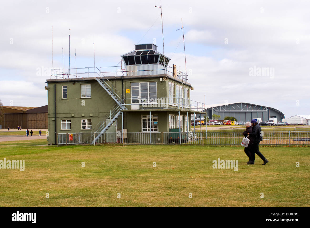 The Control Tower with Aircraft Hangars Behind at Duxford Aerodrome IWM Cambridgeshire England United Kingdom UK - Stock Image