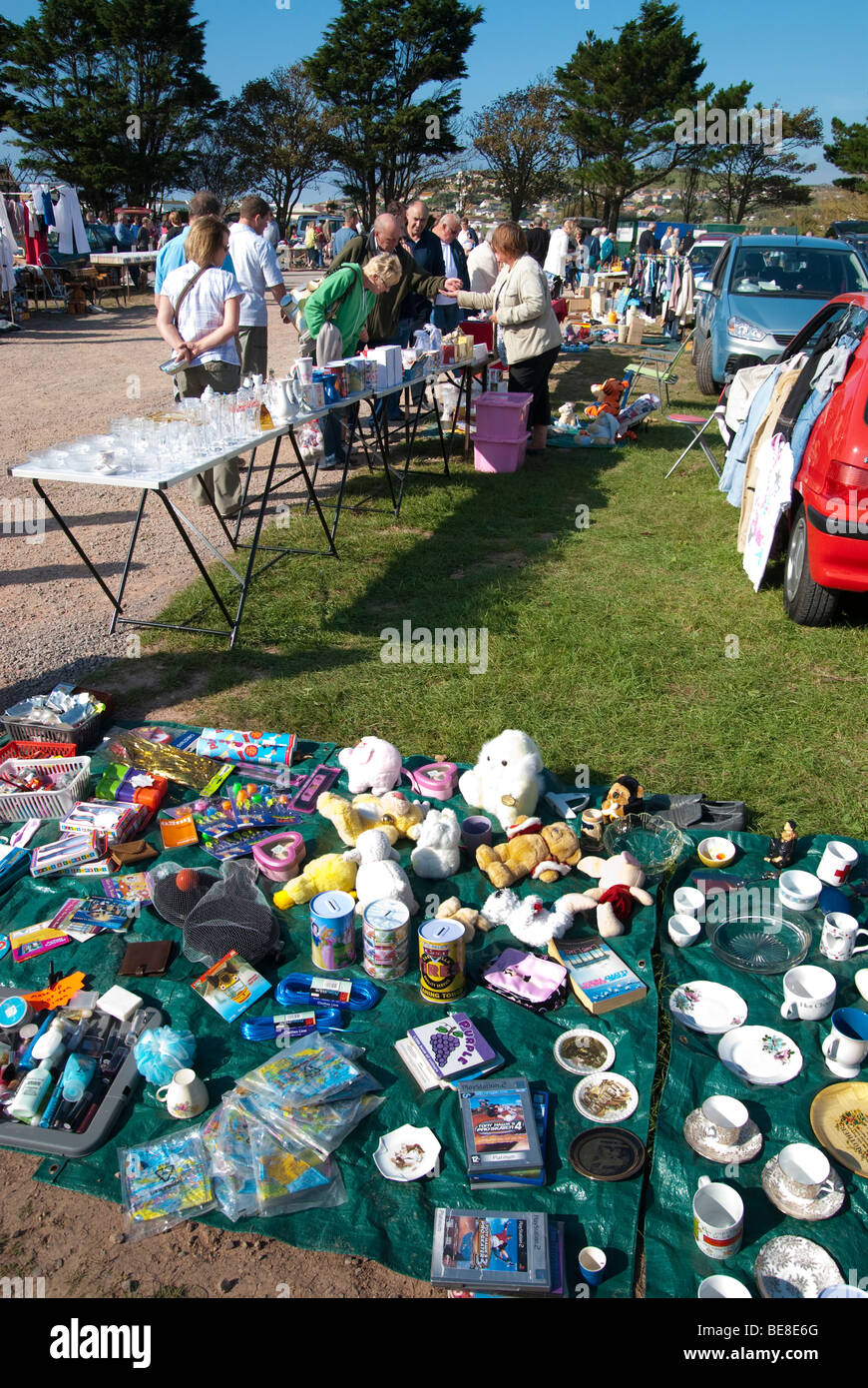 Traders and customers at a Sunday car boot sale in West Bay, Dorset - Stock Image